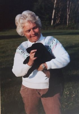 photo of Katharine Simonds with a black lab puppy