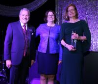 Photo of Dr. Kristin Bloink accepting the 2019 AKC Canine Health Foundation's President's Award from Board Chairman Dr. Charles Garvin and CHF Chief Executive Officer, Dr. Diane Brown.