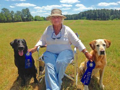 photo of Katharine Simonds with two Labrador Retrievers